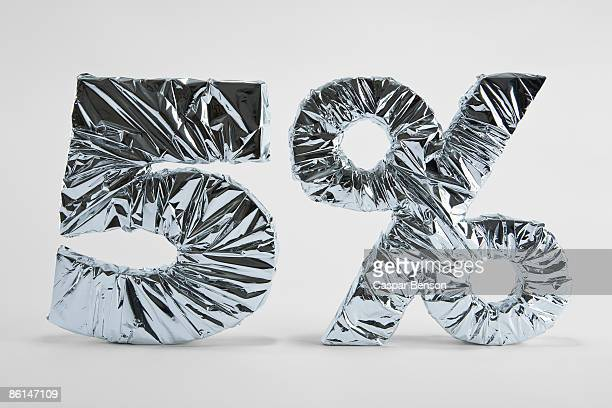 5% sign wrapped silver foil - percentage sign stock pictures, royalty-free photos & images