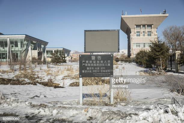 A sign written in Chinese and Korean displays the message Warning Sheltering those who illegally cross the border andtraffickingwomen and children...