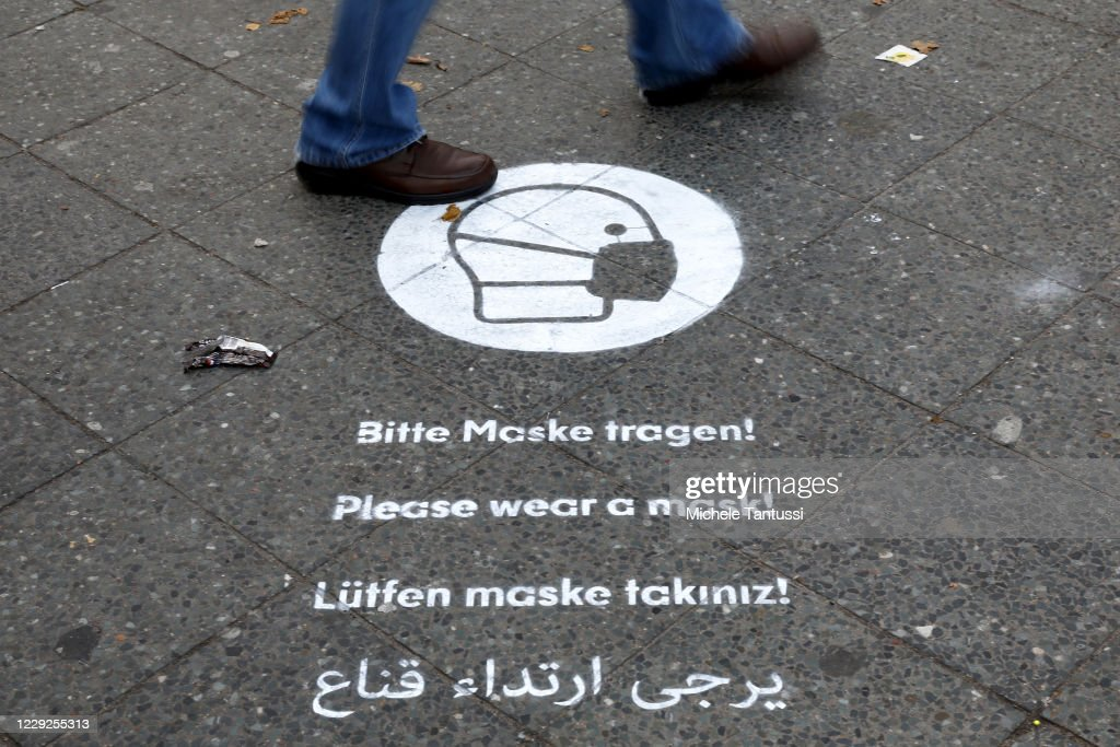 Berlin Mandates Face Masks Outside In Commercial Areas : News Photo