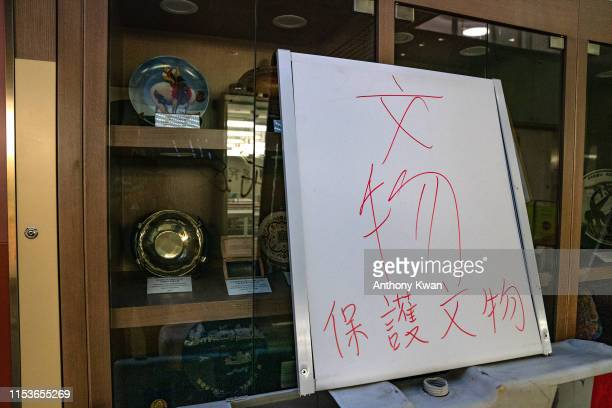 A sign written Protect heritage antique is seen in front of a display shelf during a media tour at the Legislative Council Complex on July 3 2019 in...