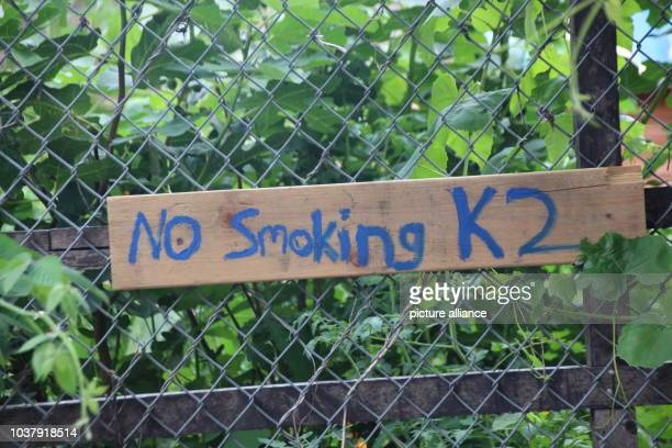 """Sign written with '""""No Smoking K2' hangs on a fence in the 'Bushwick City Farm' community gardenin the borough of Brooklyn in New York, USA, 18 July..."""