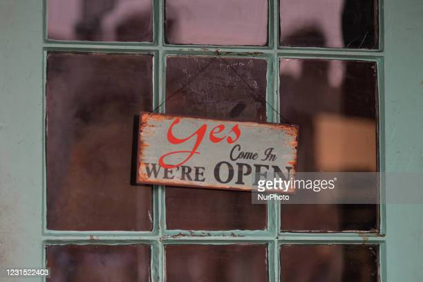 Sign 'Yes, Come In, We're Open' seen at the entrance to a coffee shop in Dublin during Level 5 Covid-19 lockdown. On Thursday, 4 March in Dublin,...
