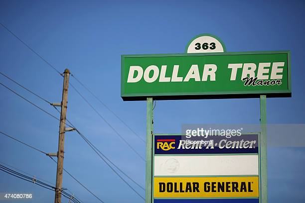 Signage advertises the location of Dollar Tree Inc and Dollar General Corp stores in Frankfort Kentucky US on Tuesday May 19 2015 Dollar Tree is...