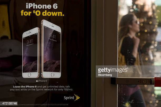 Signage advertising an Apple iPhone 6 subscription plan is displayed at a Sprint Corp. Store in Palo Alto, California, U.S., on Friday, May 1, 2015....
