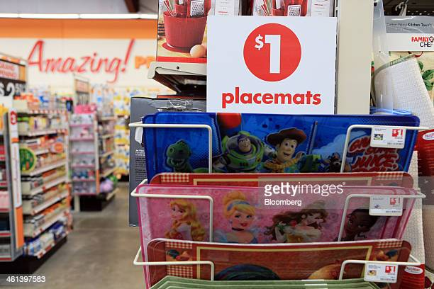 Signage advertising placemats for a dollar are displayed for sale at a Family Dollar Stores Inc location in Mansfield Texas US on Tuesday Jan 7 2014...