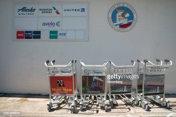 Signage and luggage trolleys outside Charles M. SchulzSonoma County Airport in Santa Rosa, California, U.S., on Wednesday, April 28, 2021. New money...