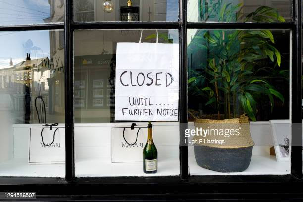 Signage at a closed retail outlet on January 5, 2021 in Falmouth, United Kingdom. The British Prime Minister made a national television address on...