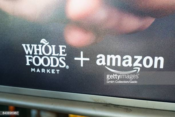 Signage at the Whole Foods Market store in San Ramon California reading 'Whole Foods Market and Amazon' announcing the acquisition of Whole Foods...