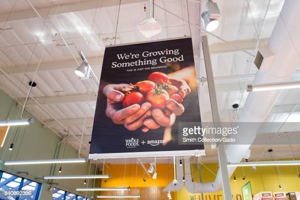 Signage at the Whole Foods Market store in San Ramon California reading 'We're growing something good' announcing the acquisition of Whole Foods...