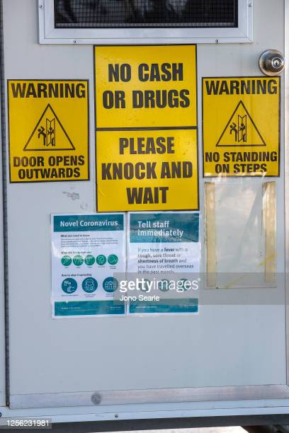Signage cautioning against the coronavirus are seen on a dental clinic van at Surfers Paradise on July 15, 2020 in Gold Coast, Australia. Pop up...