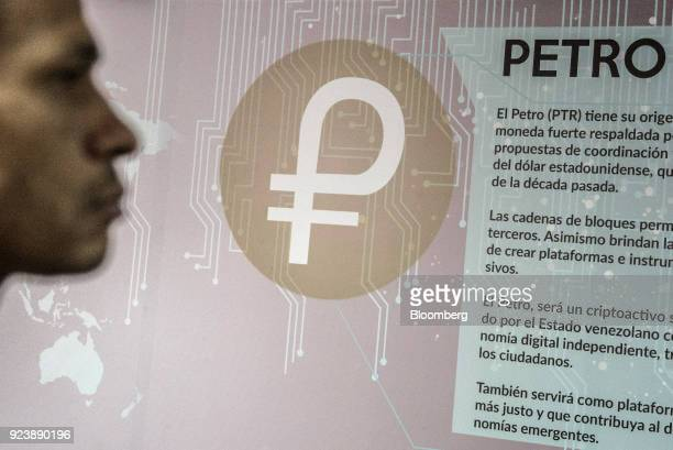Signage describing the Petro cryptocurrency is displayed on a wall inside the mining farm and school at the Ministry of Youth and Sports facility in...