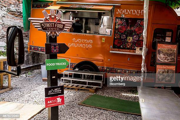 Signage directs customers at the Street Food Center in a park in the Roma neighborhood of Mexico City Mexico on Monday Aug 31 2015 The Street Food...