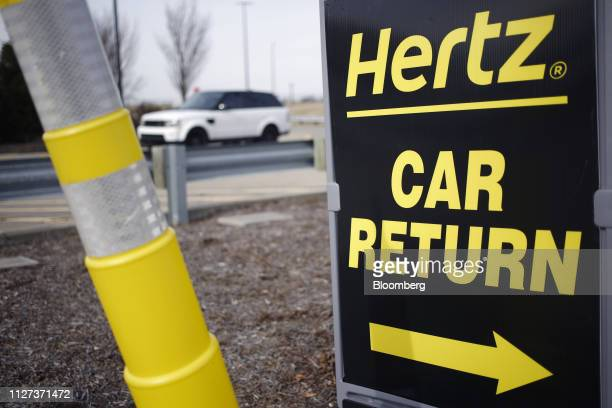 Signage directs motorists to a car return location at a Hertz Global Holdings Inc rental lot at Louisville International Airport in Louisville...