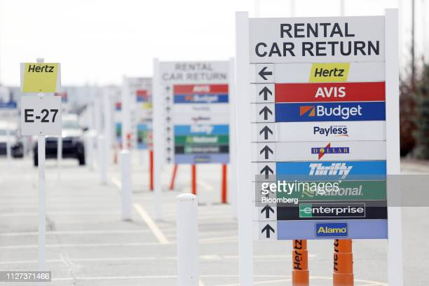 Signage directs motorists to car return locations at a Hertz Global Holdings Inc rental lot at Louisville International Airport in Louisville...