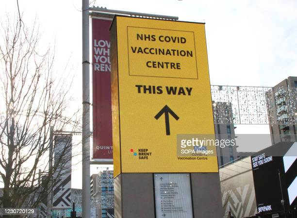 Signage directs the public to the NHS vaccination centre. A steady stream of elderly people with pre-booked appointments at the new Covid-19...