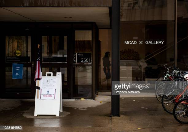 Signage directs voters at the Minneapolis College of Art and Design on November 6 2018 in Minneapolis United States Voters in Minnesota will be...