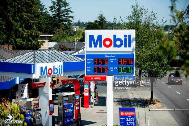 Signage displays fuel prices at an Exxon Mobil Corp gas station in Seattle Washington US on Wednesday July 25 2018 Exxon Mobil Corp is scheduled to...