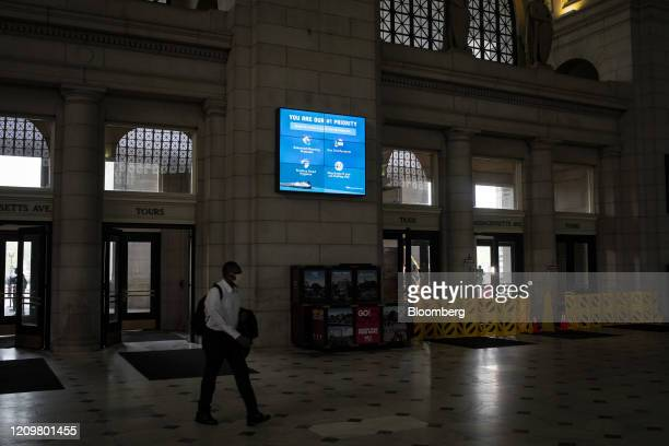 Signage displays information about the coronavirus at Union Station in Washington, D.C., U.S., on Monday, April 13, 2020. Congress faces intense...