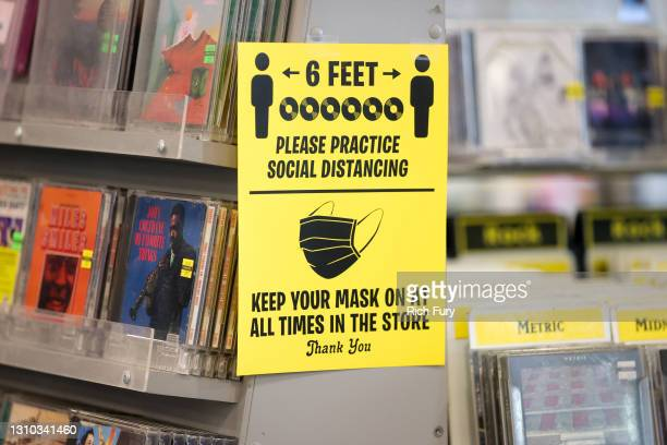 Signage encouraging social distancing and mask-wearing is seen at Amoeba Music during their grand re-opening at their new location on Hollywood...