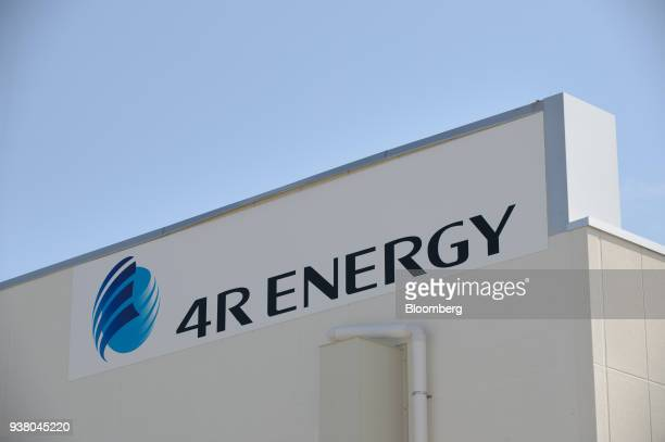 Signage for 4R Energy Corp is displayed atop the company's factory in Namie Town Fukushima Prefecture Japan on Monday Mar 26 2018 4R Energy a joint...