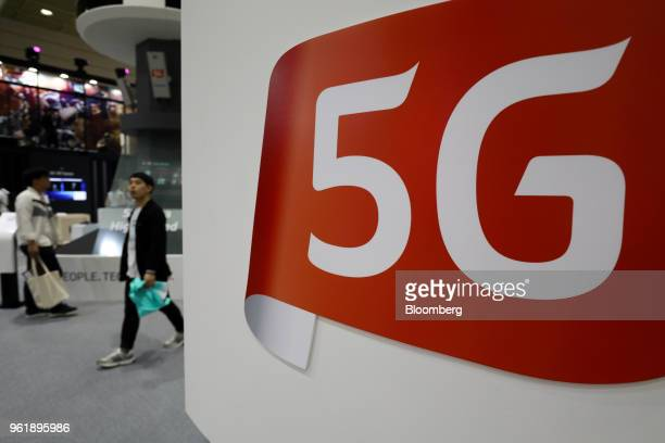 Signage for 5G is displayed at the KT Corp booth at the World IT Show 2018 in Seoul South Korea on Wednesday May 23 2018 The show runs through May 27...
