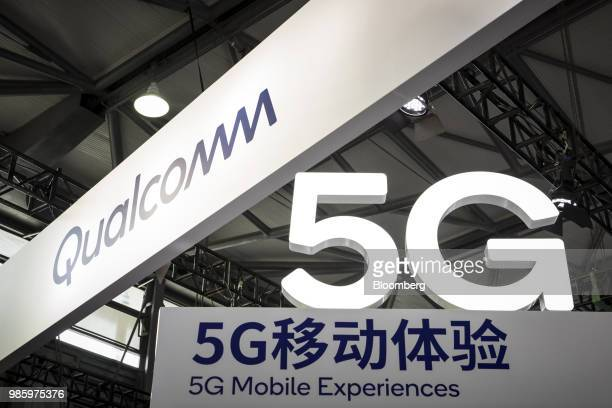 Signage for 5G mobile experiences is seen at the Qualcomm Inc booth at the Mobile World Congress Shanghai in Shanghai China on Thursday June 28 2018...