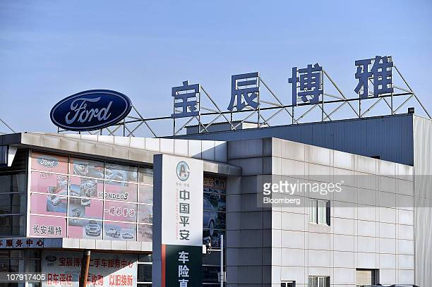 Signage for a Ford Motor Co dealership sits sits a top a showroom in Beijing China Friday Jan 7 2011 Ford Motor Co said its vehicle sales in China...