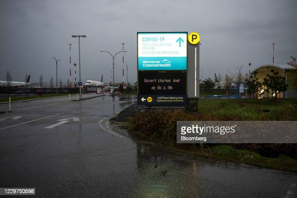 Signage for a new Covid-19 test collection center near the Vancouver International Airport in Richmond, British Columbia, Canada, on Wednesday, Nov....