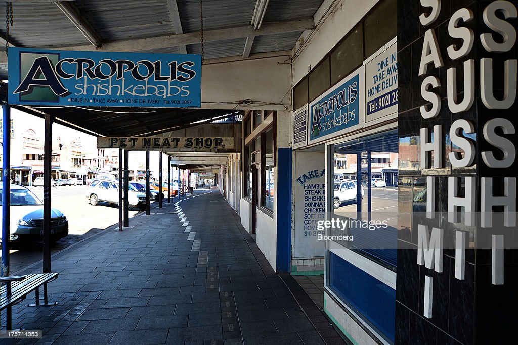 Signage for a sushi cafe, a kebab shop and a pet meat store are displayed in Kalgoorlie, Australia, on Wednesday, Aug. 7, 2013. Kalgoorlie, a town in the Goldfields-Esperance region of Western Australia, is home to the annual Diggers & Dealers mining forum. Photographer: Carla Gottgens/Bloomberg via Getty Images