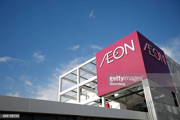 Signage for Aeon Co is displayed atop the Aeon Mall Makuhari Shintoshin shopping mall operated by Aeon Mall Co in Chiba Japan on Friday Dec 20 2013...
