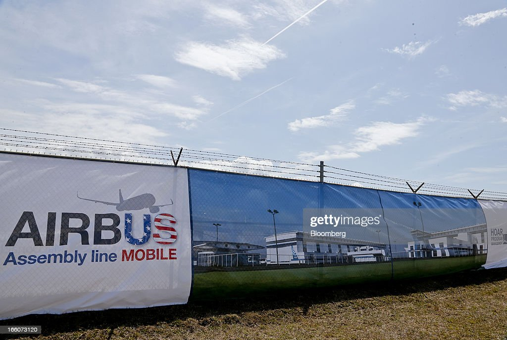 Signage for Airbus SAS and images of their planned Airbus Assembly Line Mobile facility are displayed during a groundbreaking ceremony in Mobile, Alabama, U.S., on Monday, April 8, 2013. Airbus SAS will probably seek some flexibility from its largest customers on delivery of the A320neo single-aisle jet to help accommodate new buyers, as the company tries to work through a record order book for the plane. Photographer: Derick E. Hingle/Bloomberg via Getty Images