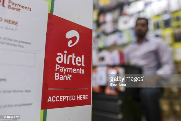 Signage for Airtel Payments Bank Ltd operated by Bharti Airtel Ltd is displayed outside a mobile accessories store in Bengaluru India on Saturday Feb...