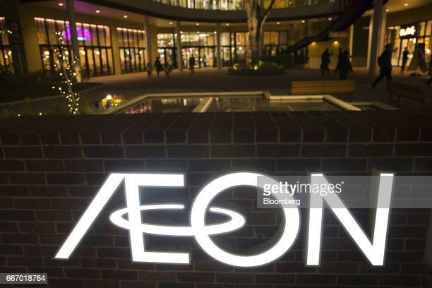 Signage for an Aeon shopping mall operated by Aeon Mall Co a unit of Aeon Co stands in Tokyo Japan on Monday April 10 2017 Aeon Co Japan's biggest...