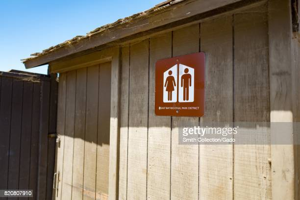 Signage for an allgender restroom outdoors in an East Bay Regional Park in the San Francisco Bay Area town of Alameda California July 20 2017 In 2017...