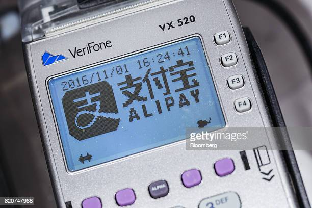 Signage for Ant Financial Services Group's Alipay service an affiliate of Alibaba Group Holding Ltd is displayed on a payment machine inside a Sa Sa...