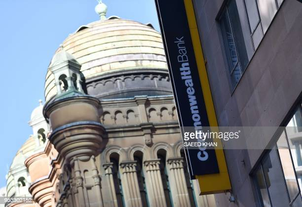 Signage for Australia's biggest company the Commonwealth Bank is seen on a building in Sydney on May 1 2018 The Commonwealth Bank has a complacent...