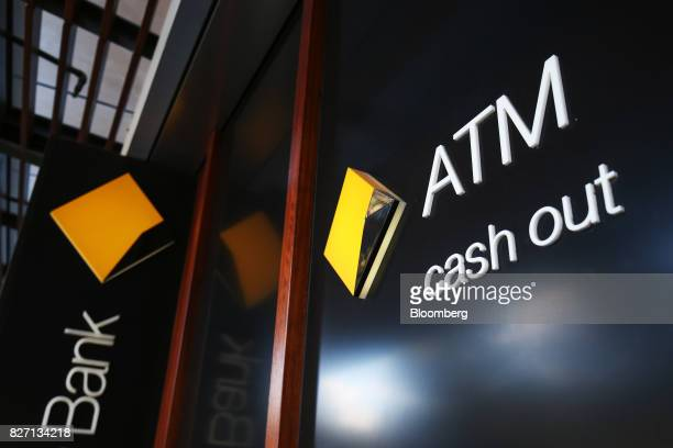Signage for automated teller machines is displayed outside a Commonwealth Bank of Australia branch in Sydney Australia on Monday Aug 7 2017...