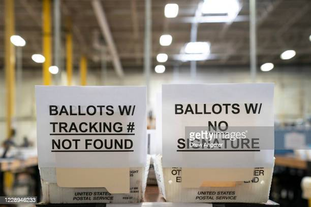 Signage for ballots with errors is seen in a warehouse at the Anne Arundel County Board of Elections headquarters on October 7, 2020 in Glen Burnie,...