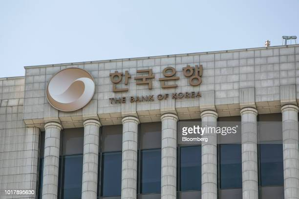 Pedestrians walk past the Bank of Korea museum at the central bank's headquarters in Seoul South Korea on Thursday Aug 16 2018 While the Bank of...