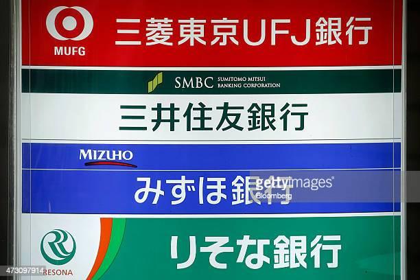 Signage for Bank of Tokyo Mitsubishi UFJ from top Sumitomo Mitsui Banking Corp Mizuho Bank Ltd and Resona Bank Ltd are displayed on a board outside a...