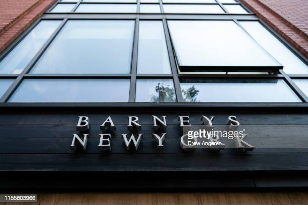 Signage for Barneys New York hangs above the entrance to the store in Brooklyn Heights July 15 2019 in New York City According to news reports...