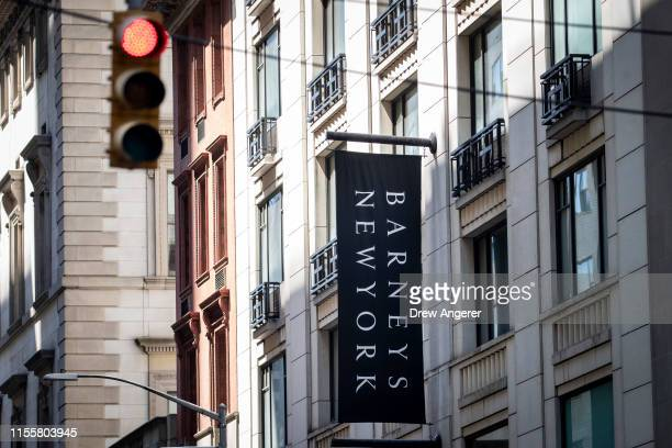 Signage for Barneys New York hangs on the side of the store in Midtown Manhattan July 15 2019 in New York City According to news reports Barneys New...