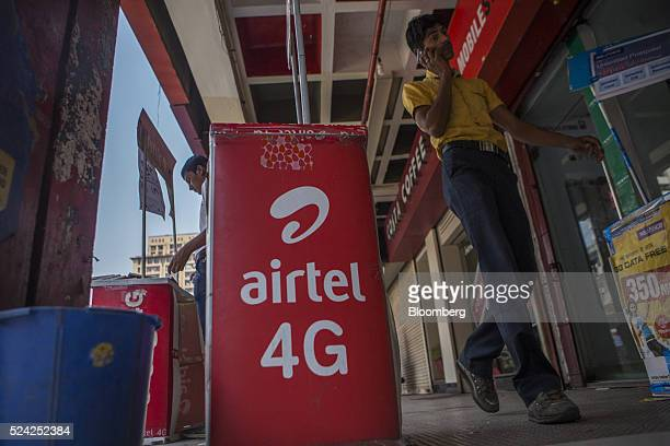 Signage for Bharti Airtel Ltd is displayed outside a store in New Delhi India on Sunday April 24 2016 Bharti India's largest mobilephone carrier has...