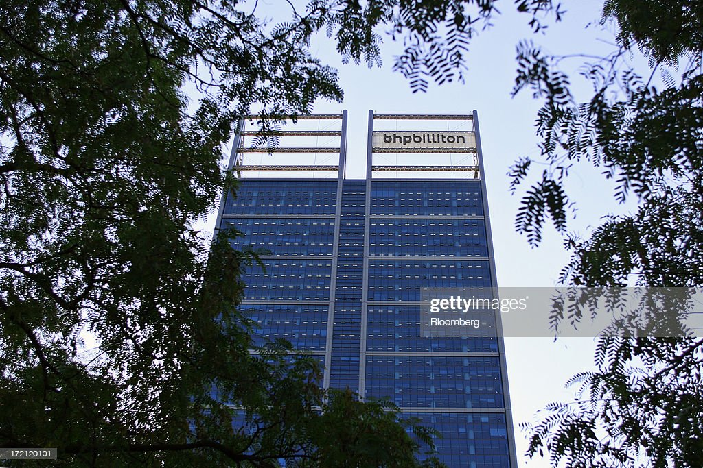 Signage for BHP Billiton Ltd. is displayed atop the Brookfield Place Tower in Perth, Australia, on Tuesday, July 2, 2013. BHP Billiton is the world's largest mining company. Photographer: Sergio Dionisio/Bloomberg via Getty Images