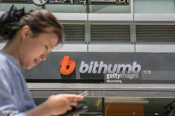 Signage for Bithumb is displayed at an exchange office in Seoul South Korea on Wednesday June 20 2018 Virtual currencies dropped after Bithumb the...