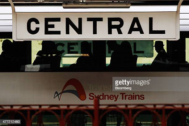 Signage for Central Station is displayed at a platform as commuters riding on a train wait to depart in Sydney Australia on Tuesday June 9 2015...