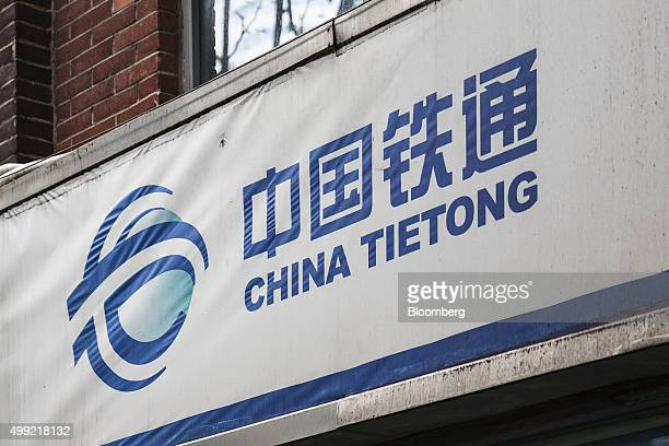 Signage for China Tietong Telecommunications Corp is displayed at one of the company's stores in Shanghai China on Sunday Nov 29 2015 China Mobile...