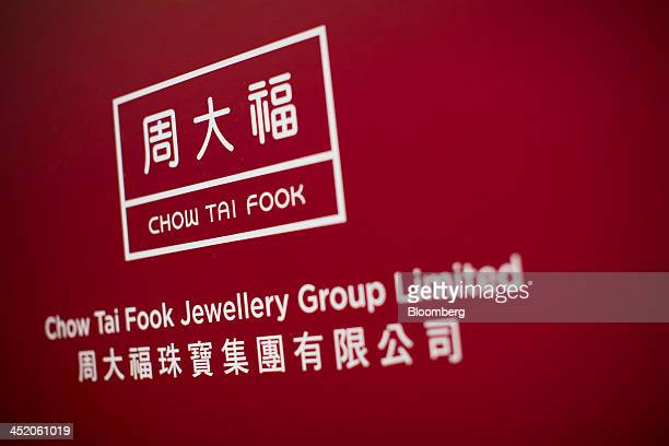 Signage for Chow Tai Fook Jewellery Group Ltd is displayed during a news conference in Hong Kong China on Tuesday Nov 26 2013 Chow Tai Fook the...
