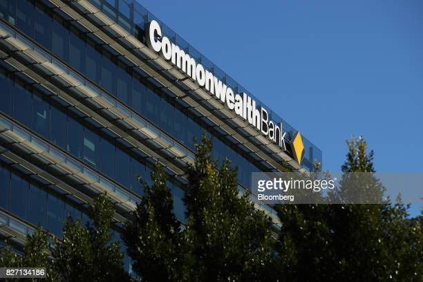 Signage for Commonwealth Bank of Australia is displayed atop the Commonwealth Bank Place building in Sydney Australia on Monday Aug 7 2017...