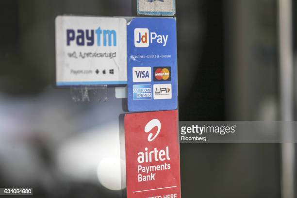 Signage for digital payments services Paytm operated by One97 Communications Ltd top left JD Pay operated by Just Dial Ltd top right and Airtel...